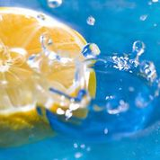 Lemon slice with water drops